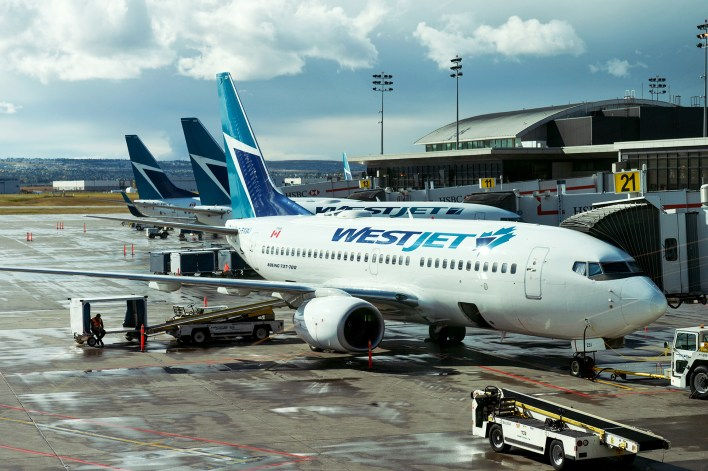 WestJet planes at Calgary International Airport.