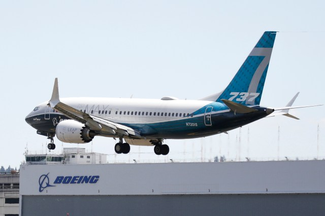 A Boeing 737 MAX jet lands after a FAA test flight at Boeing Field in Seattle.
