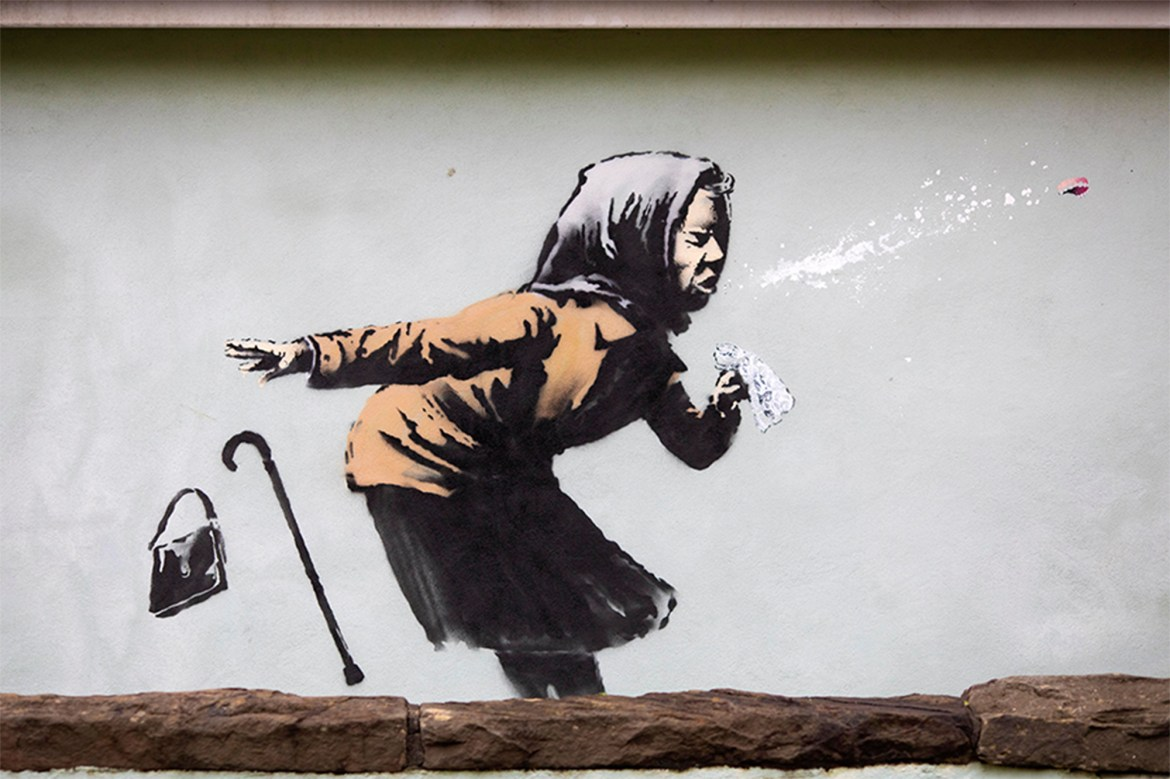 Banksy street art depicting sneezing woman appears on English home 1