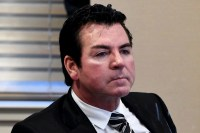 Papa John's founder's use of N-word not racist, his lawyers claim