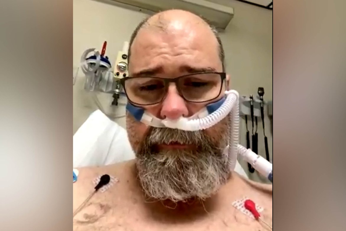 COVID anti-masker gasps for breath as he issues plea from hospital bed 1
