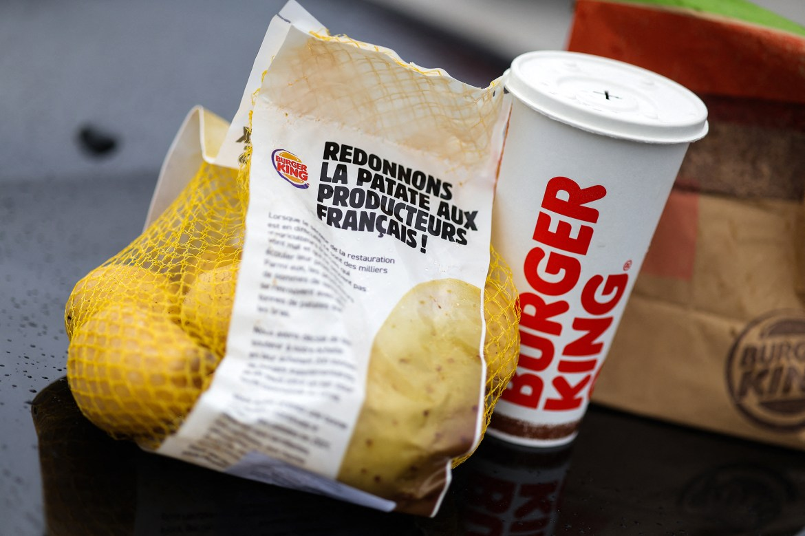 The fast food chain, Burger King, starts today Tuesday, February 02, 2021 a campaign to support farmers by offering a 1kg bag of potatoes to each customer of the drive of restaurants throughout France. Bordeaux, France on February 2, 2021.