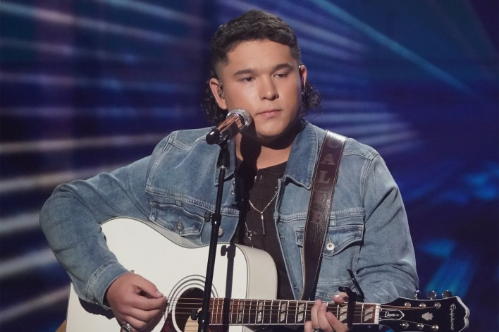 """Caleb Kennedy performs on """"American Idol"""" on Sunday, May 9. A top-five finalist, he withdrew from the competition when a controversial video emerged."""