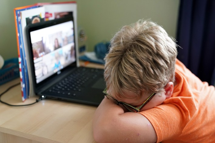 general view of a grammar school student participating in a remote learning class