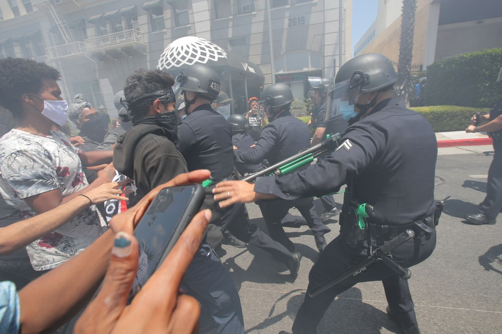 WATCH: Riot police break up dueling transgender rights protests outside LA spa