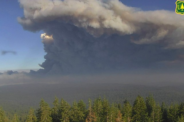 In this photo from the US Forest Service Wildfire Monitoring Camera, smoke rises from a Caldor fire in El Dorado County, California, on Tuesday, August 17, 2021.