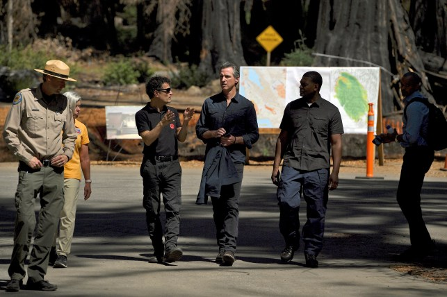 Government of California Gavin Newsom, Center, Bowler Creek, California, Tuesday, August 17, 2021, near Big Basin Redwoods State Park, talking to nail fire officials.
