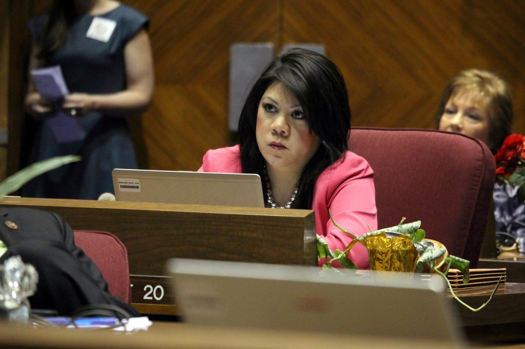 Republican Arizona state Sen. Kimberly Yee watches as the vote tally on a children's health insurance bill she opposed shows the measure passing on May 6, 2016, at the Capitol in Phoenix.