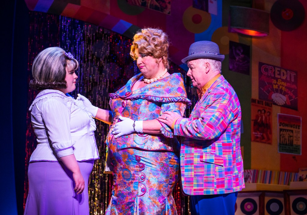 """Lizzie Bea, from left, Michael Ball and Les Dennis star in """"Hairspray"""" in the West End."""