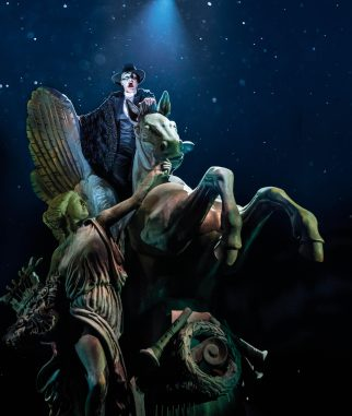 Killian Donnelly, sitting on a new Pegasus statue, plays the Phantom of the Opera in London.