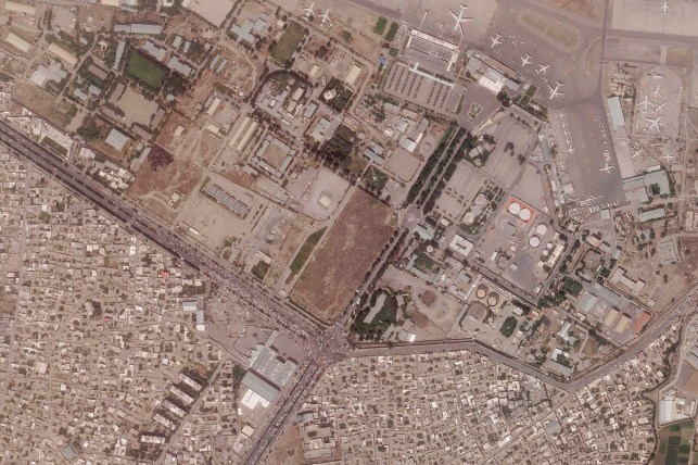 This satellite image, provided by Planet Labs Inc., shows Kabul International Airport, also known as Hamid Karzai International Airport, trying to reach the urban area on Wednesday, August 18, 2021. Is.  The Pentagon said Tuesday that US commanders were in talks with the Taliban.  When they evacuate thousands of people through the airport.  The Taliban on Tuesday cleared the urban part of the airport and controlled access to it.
