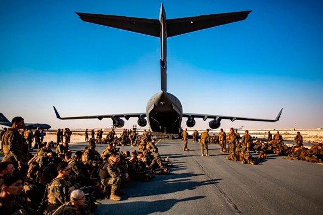 Marines at Al-Adeed Air Base, Qatar look forward to a flight to Kabul on August 17, 2021.