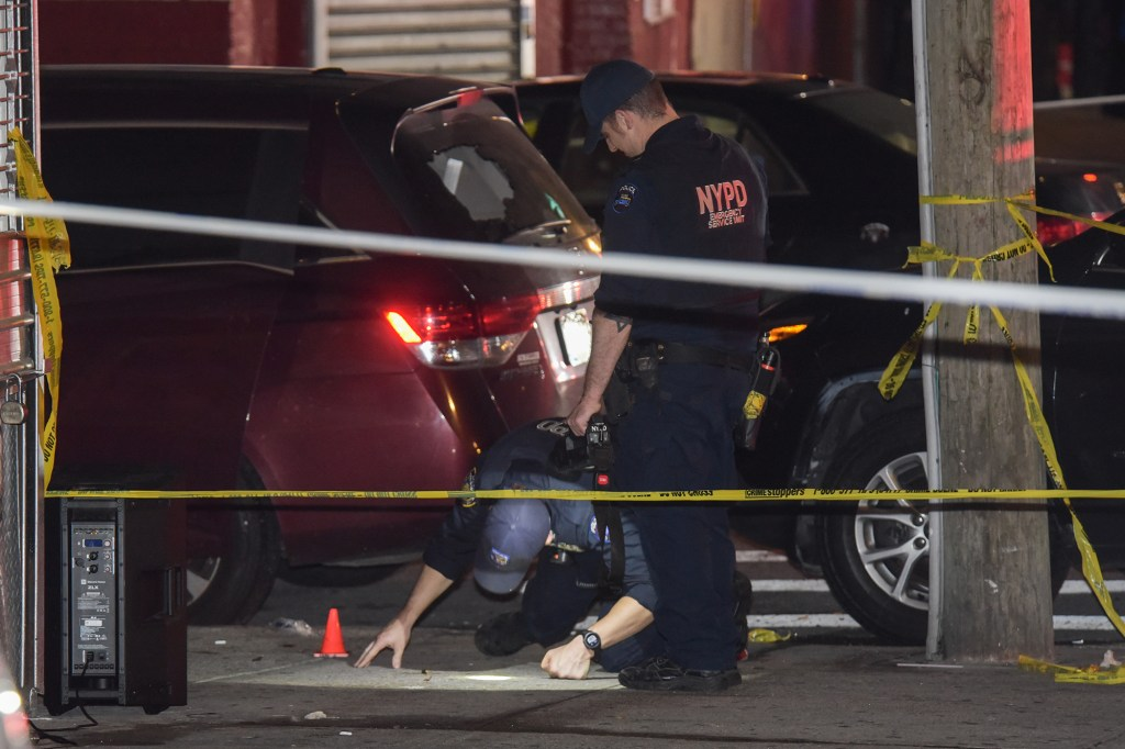 Cops at the scene of a shooting in the Bronx.