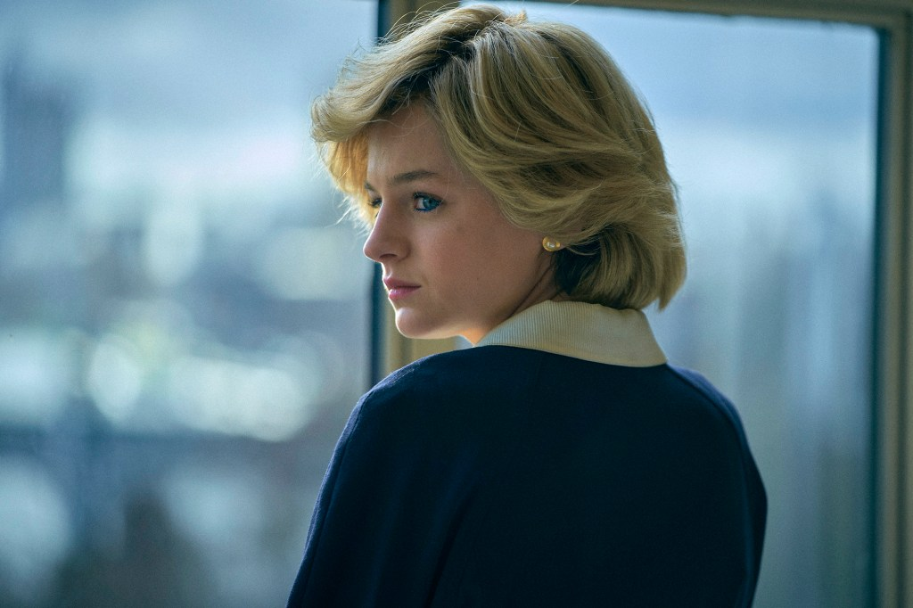 """Emma Corrin as Princess Diana in """"The Crown"""" looks out of a window."""