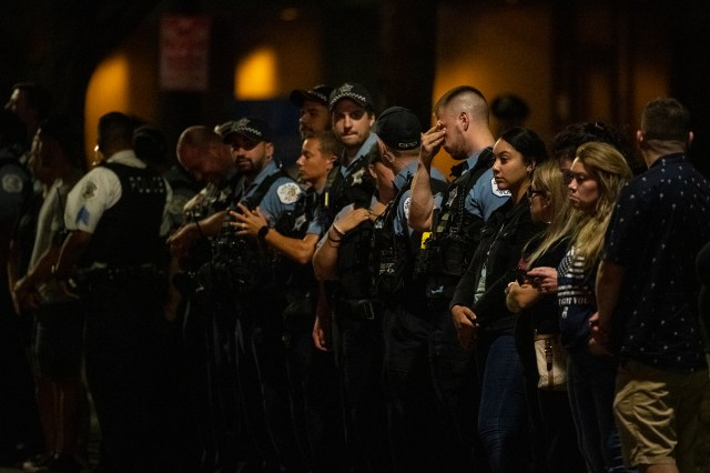Officers standing in line outside the Cook County Medical Examiners Office during a procession for slain cop Ella French on Aug. 8, 2021.