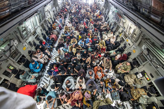 Afghan citizens packed into a British armed forces plane to flee the country on August 21, 2021.