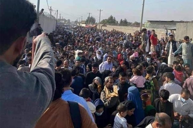 A large crowd of people at the airport in Kabul, Afghanistan attempting to flee the country on August 19, 2021.