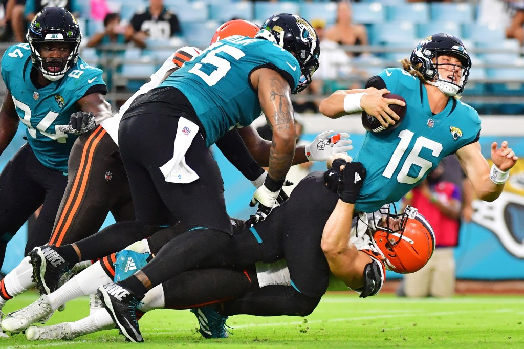 Trevor Lawrence takes a hit in the Jaguars' first preseason game against the Browns.