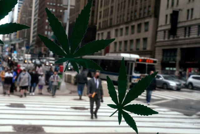 Cannabis stickers on a Weed World store window are pictured the day New York State legalized recreational marijuana use amid the coronavirus disease (COVID-19) pandemic in the Manhattan borough of New York City, New York, U.S., March 31, 2021.