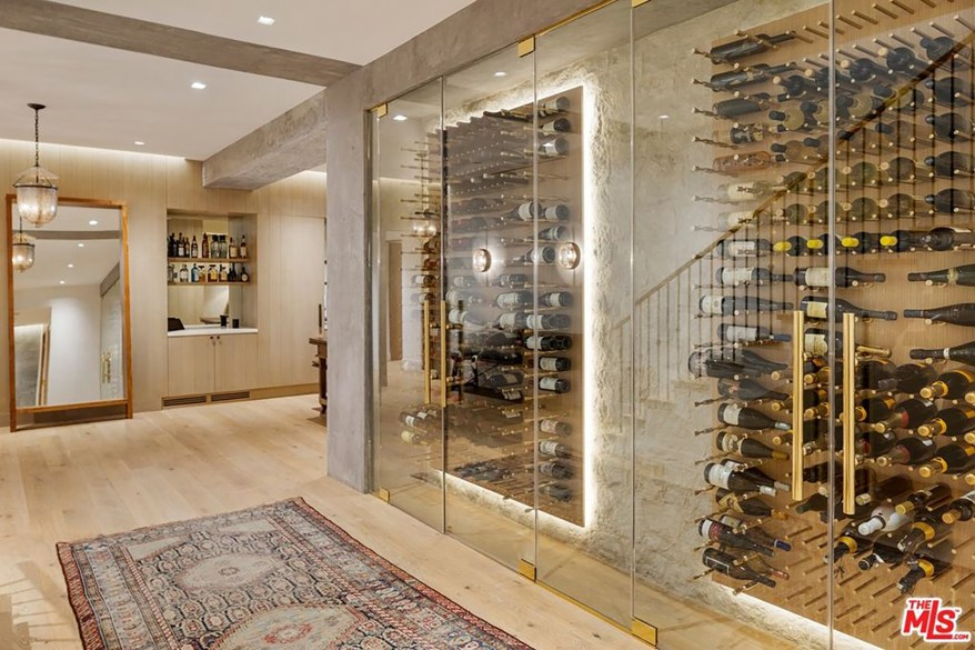 The wine cellar has room for approximately 500 bottles, photos show.