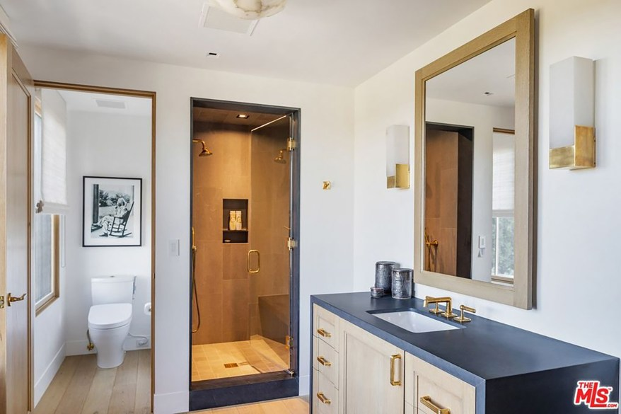 A luxurious shower is pictured in one of the bathrooms.