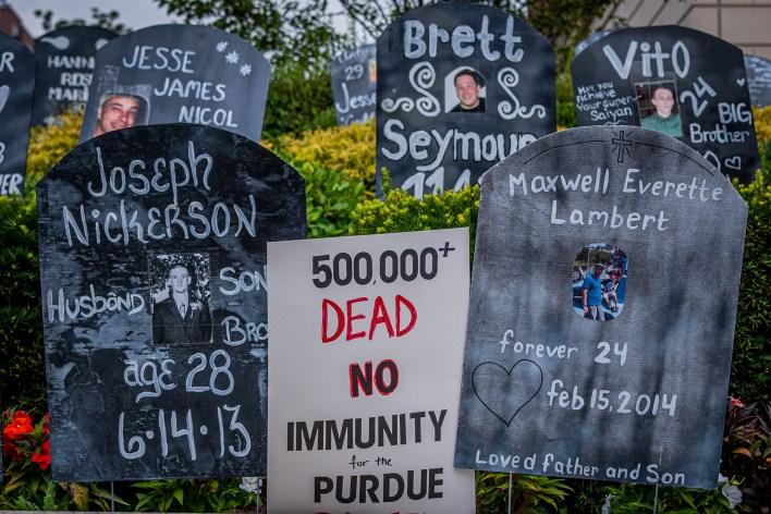 An anti-Purdue exhibit shows gravestones of opioid overdose victims
