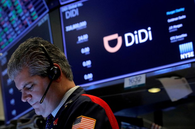 A trading floor seen with a glowing Didi sign