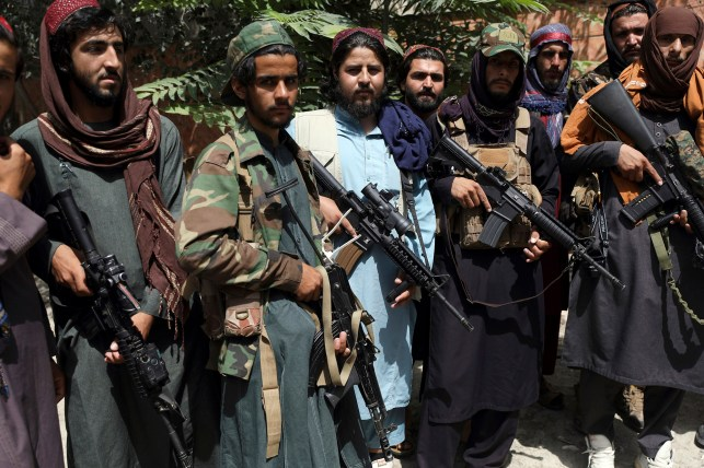Taliban fighters pose for a photo in Kabul's Wazir Akbar Khan.