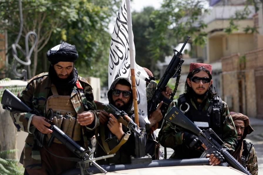 Taliban fighters patrol Kabul on August 19, 2021.