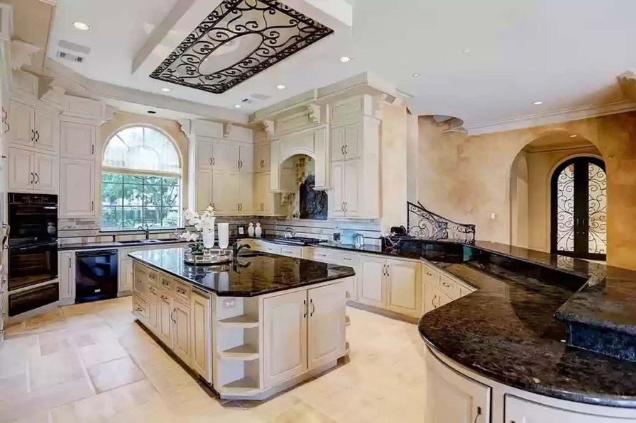 The kitchen has a breakfast bar, a butler area and a wet bar, according to Realtor.com.