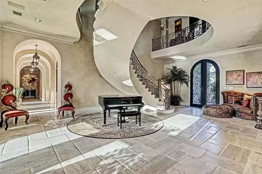 The foyer, where McGrady's wife Clerenda recently posed for an Instagram photo, has an iron staircase and French lime floors, according to the report.
