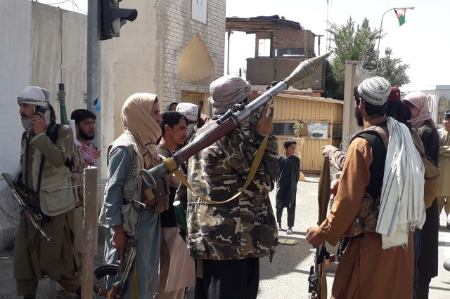 Taliban militants patrol after taking control of the Governor's house and Ghazni city, in Afghanistan, 12 August 2021.