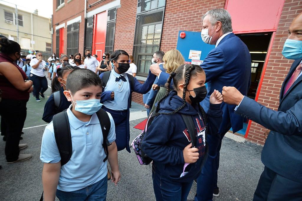 Mayor Bill de Blasio and School Chancellor Meisha Porter greet students at PS 25 on September 13, 2021.