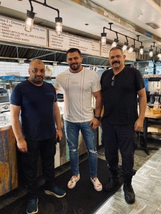 Rudy Mansy (center) is hopeful that he will be able to fill more vacancies at this resaurant Hamido Seafood in Astoria, Queens.