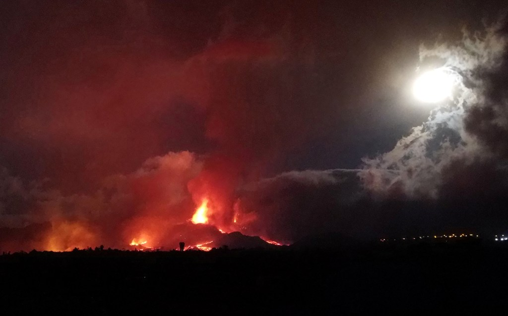 Lava and smoke rise following the eruption of a volcano on the Island of La Palma.