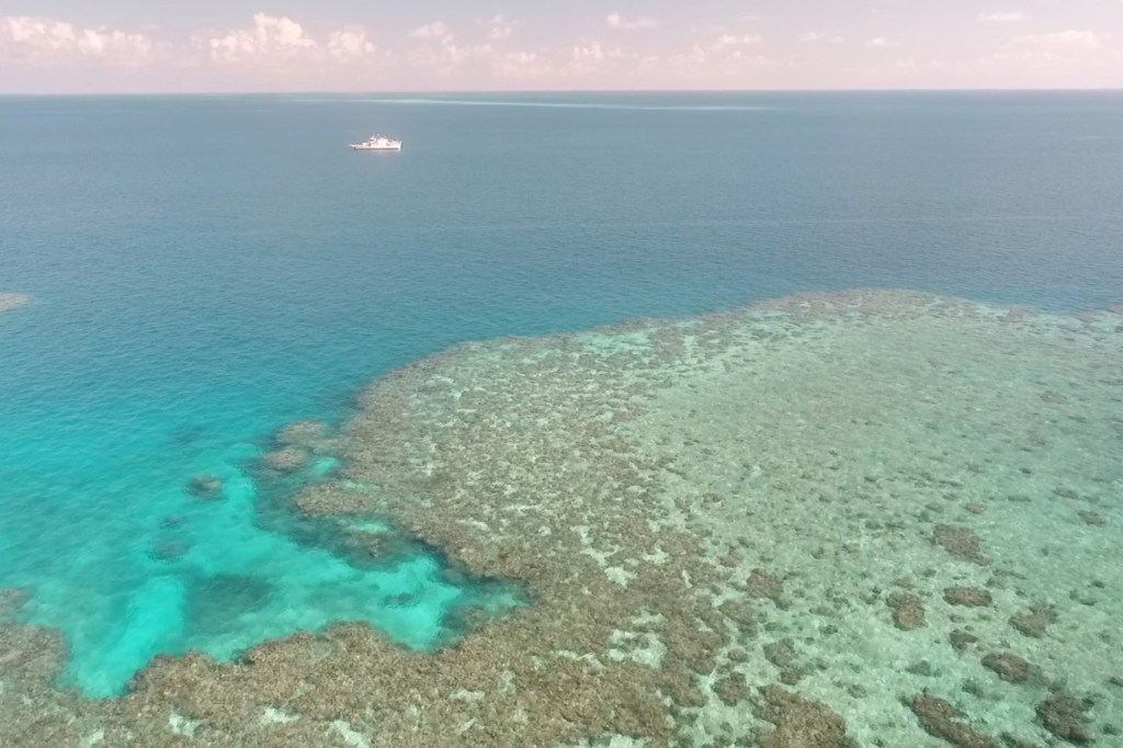 A general view of Broadhurst Reef and a research vessel during the second field trial at Broadhurst Reef on the Great Barrier Reef, Queensland, Australia in March 2021.