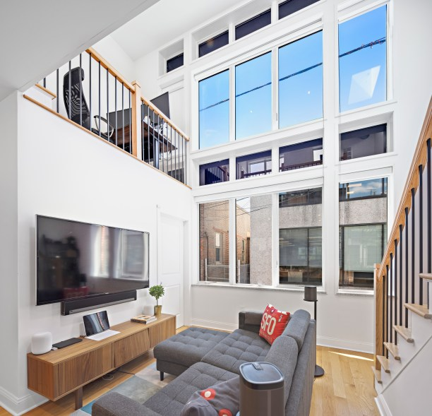 A separate carriage house with a standalone loft apartment.