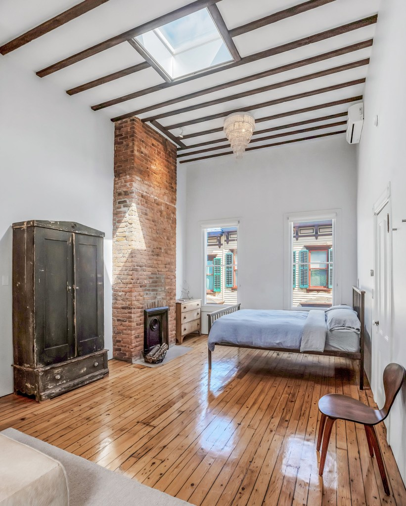 The main bedroom has high ceilings and a skylight.