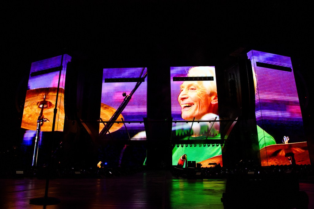 """A Charlie Watts tribute video plays before the Rolling Stones perform during the """"No filter"""" to visit."""