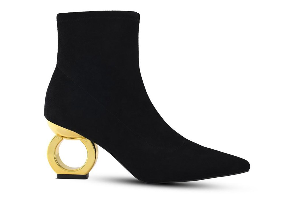 A black bootie with a circular gold heel