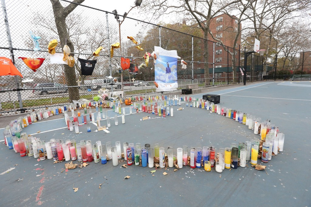 A memorial full of candles, notes and photos pay tribute to Aamir Griffin after his death in Jamaica, Queens on November 17, 2019.