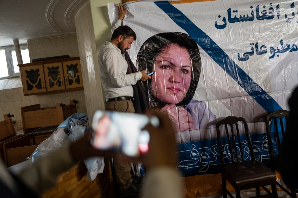 """A poster of Afghan politician Fawzia Koofi at a press conference for the """"movement of change for Afghanistan Party"""" in Kabul on September 19, 2021."""