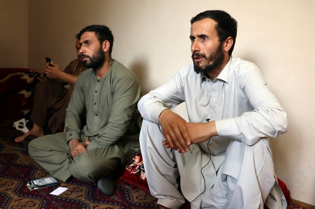Romal Ahmadi, right, speaks during an interview with The associated Press during a U.S. drone strike in Kabul.