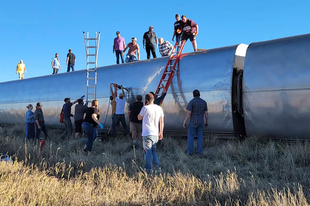 people work at the scene of an Amtrak train derailment on Saturday, Sept. 25, 2021