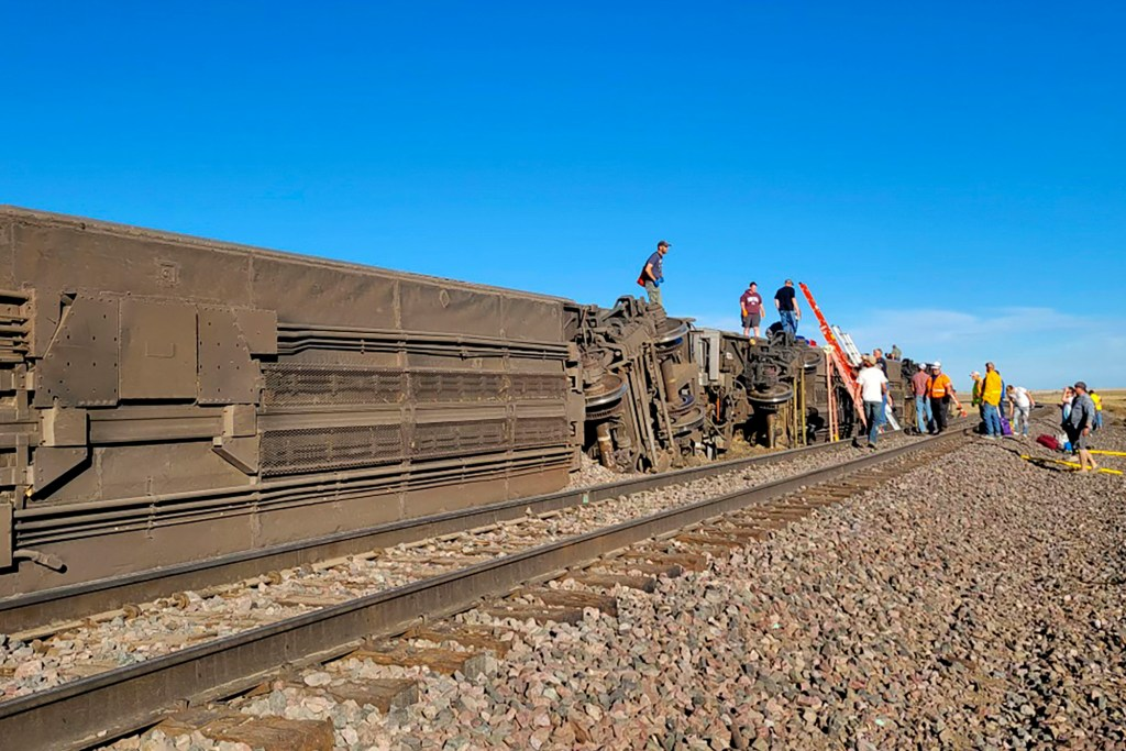 people work at the scene of an Amtrak train derailment on Saturday, Sept. 25, 2021, in north-central Montana.