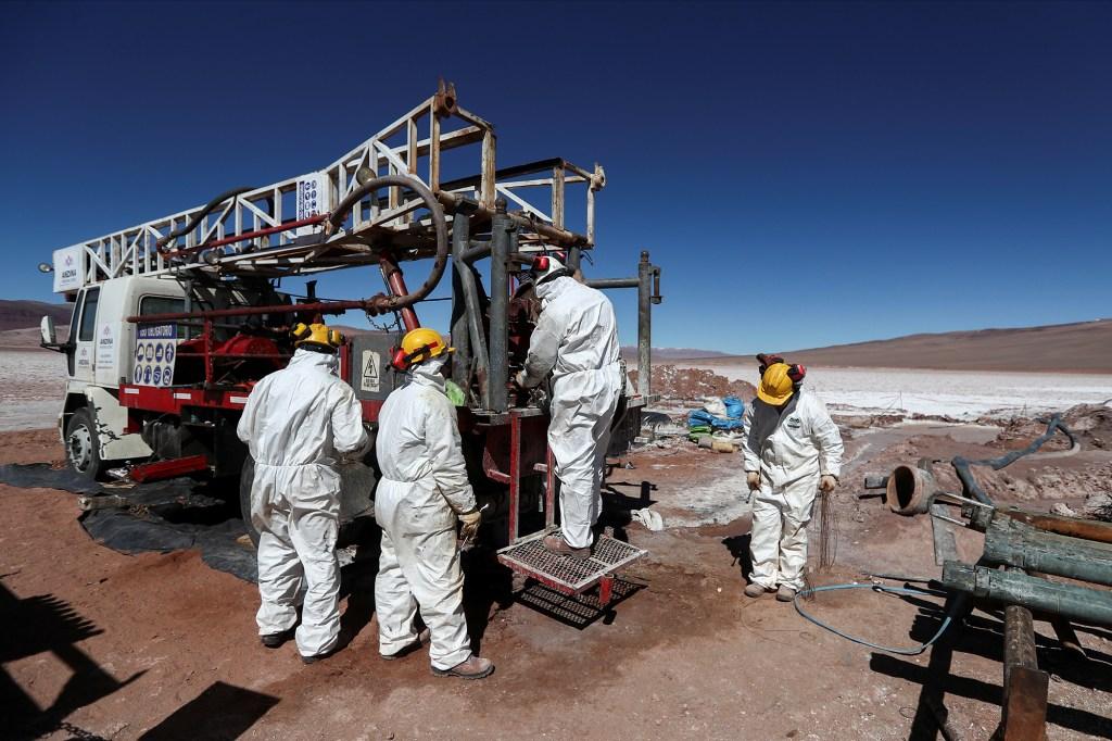 Alpha lithium employees work at the Tolillar salt flat, in Salta, Argentina August 13, 2021.