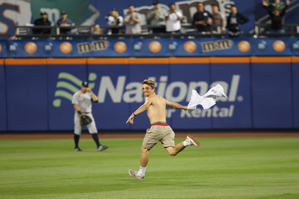 A second fan disrupted play when he ran onto the field during the eighth inning.