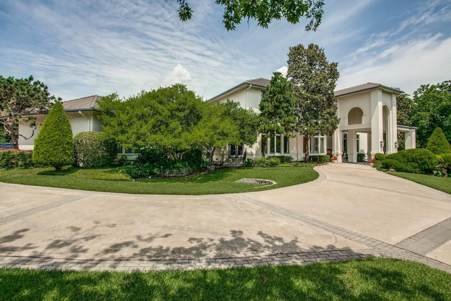 The Dallas home sits on almost an acre of land.