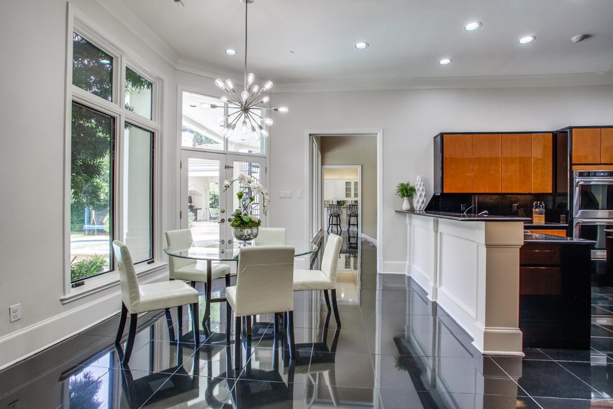 A breakfast nook sits next to the kitchen.