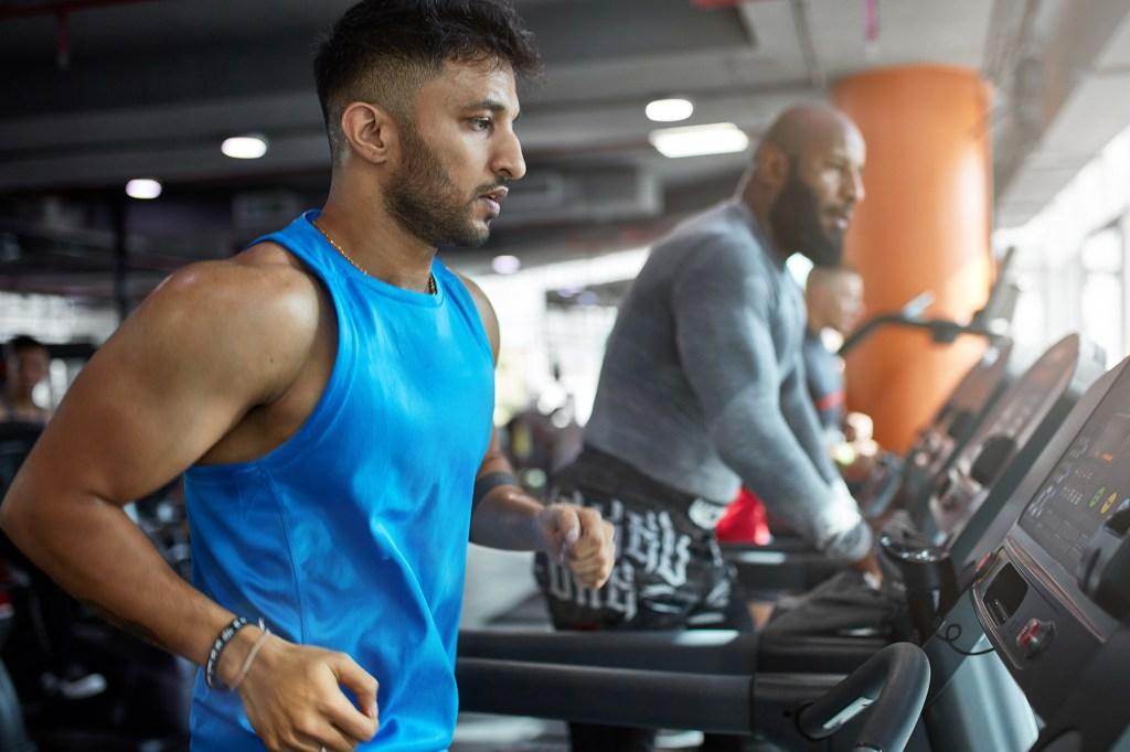 A man runs on the treadmill.